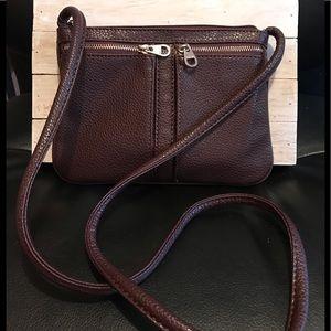 Nine West plum colored leather crossbody bag.